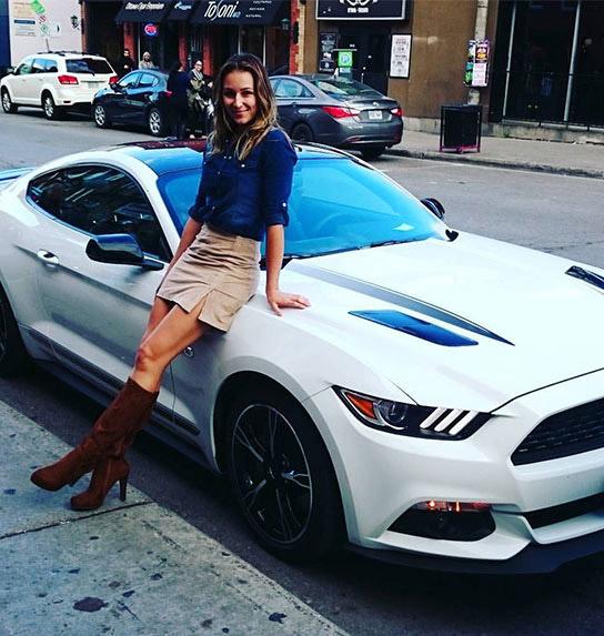 Milena Hrebacka leaning against a car